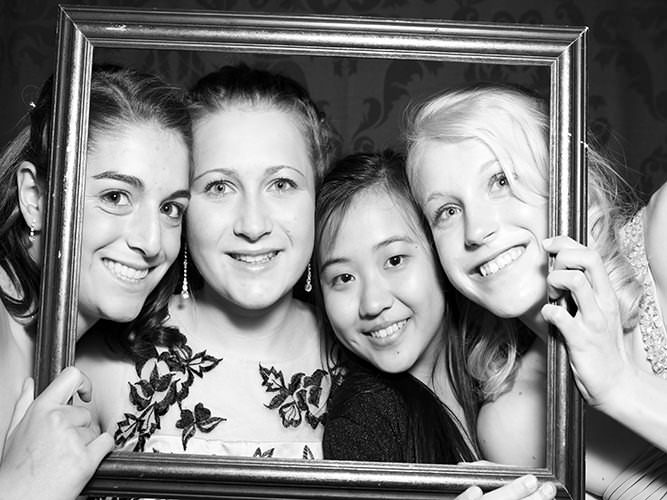 happy faces in a photo booth Boulder CO