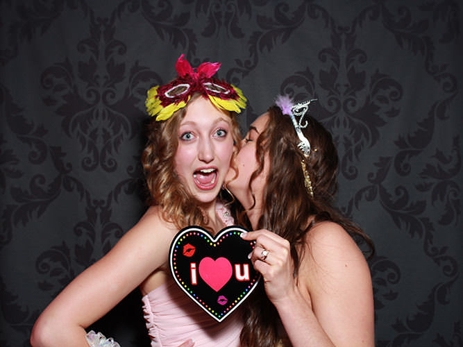 friends together in Dazzling Photo Booth rental of Boulder CO